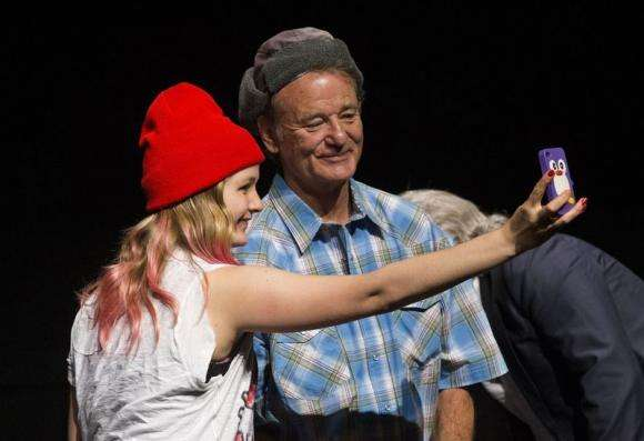 "A fan takes a selfie with Bill Murray following a screening of ""Ghostbusters"" at the Toronto International Film Festival in Toronto"