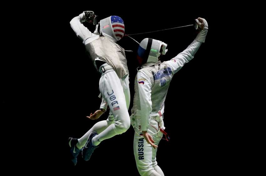 Miles Gerek Meinhardt of the U.S. competes with Artur Akhmatkhuzin of Russia in the men's foil team semifinals at the Rio Olympics August 12, 2016. REUTERS/Issei Kato