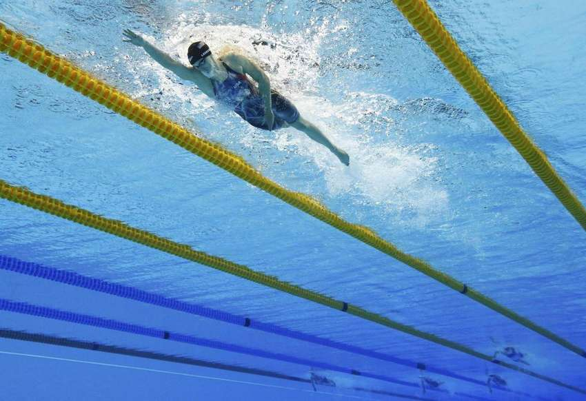 Katie Ledecky of the U.S. competes on her way to winning the gold and setting a new world record in the women's 800m freestyle at the Rio Olympics August 12, 2016. REUTERS/Stefan Wermuth