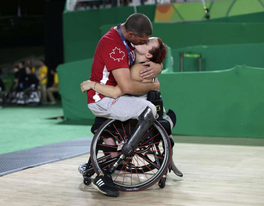 Canada's women's wheelchair basketball player Jamey Jewells kisses her husband and fellow wheelchair basketball player Adam Lancia after her playoff match against China at the Rio Paralympics September 16, 2016. REUTERS/Ueslei Marcelino