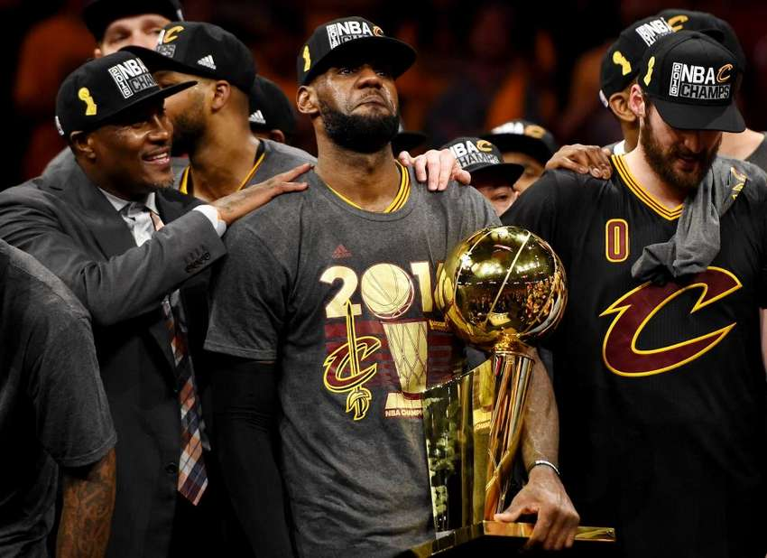 Cleveland Cavaliers forward LeBron James celebrates with the Larry O'Brien Championship Trophy after beating the Golden State Warriors in game seven of the NBA Finals at Oracle Arena June 19, 2016. Bob Donnan-USA TODAY Sports