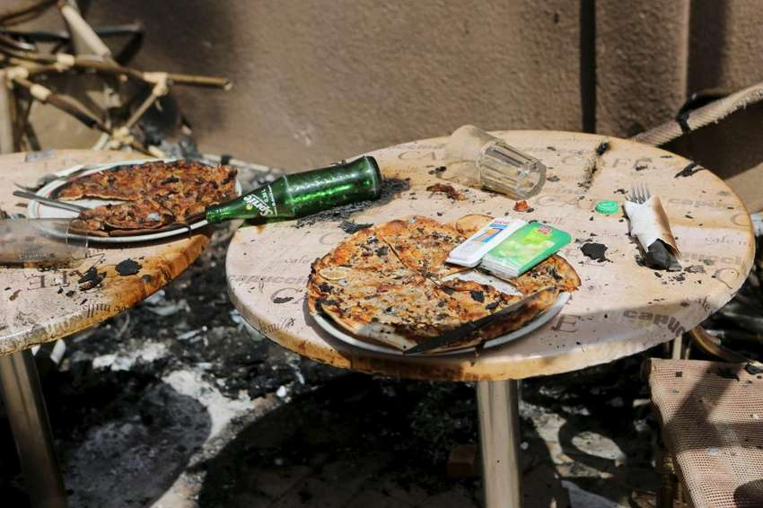 Pizzas are seen on the terrace of Cappuccino restaurant after an attack on the restaurant and the Splendid Hotel in Ouagadougou, Burkina Faso, January 18, 2016. REUTERS/Joe Penney